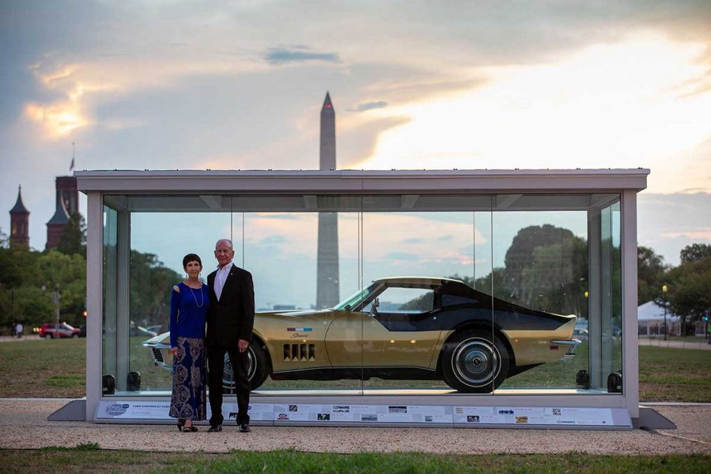 Kate and Danny Reed with their Apollo 12 astronaut Alan Bean's Corvette on display at the National Mall hardscape between the Smithsonian Air & Space Museum and the National Gallery of Art.