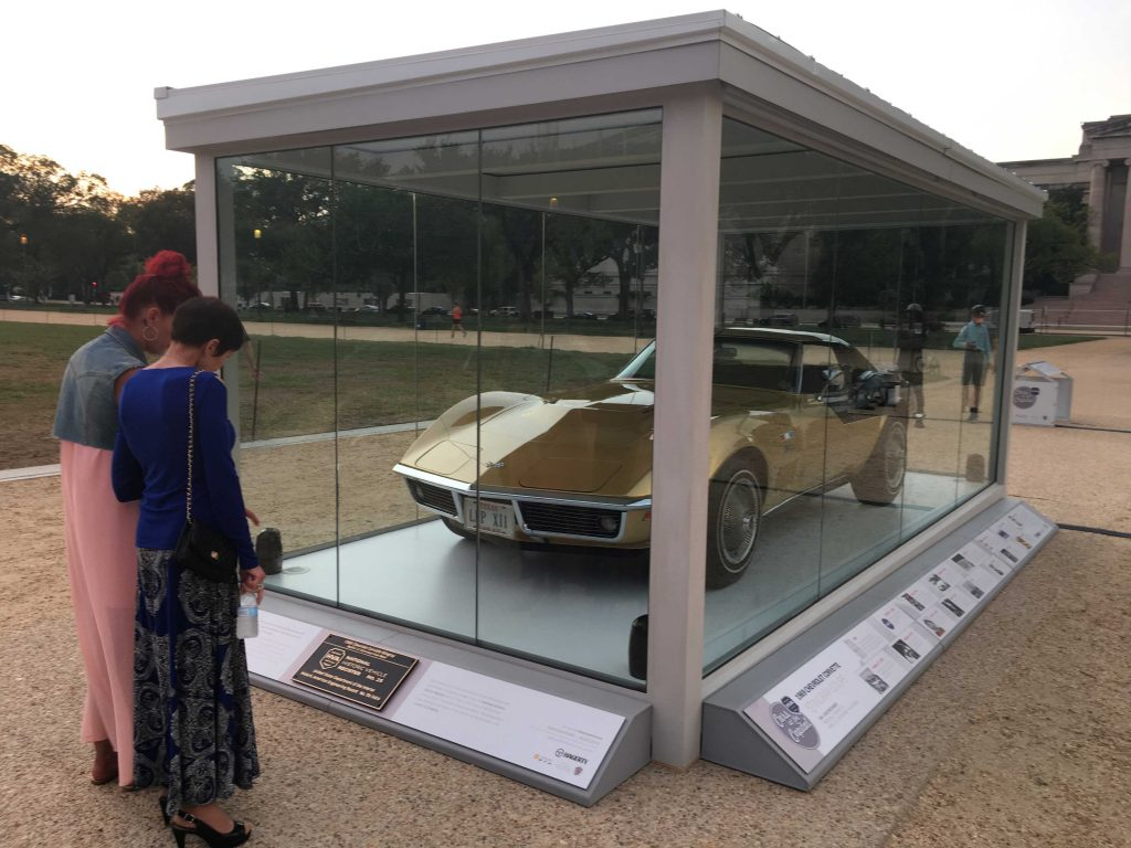 Spectators view the Apollo 12 astronaut Alan Bean's Corvette on display at the National Mall.