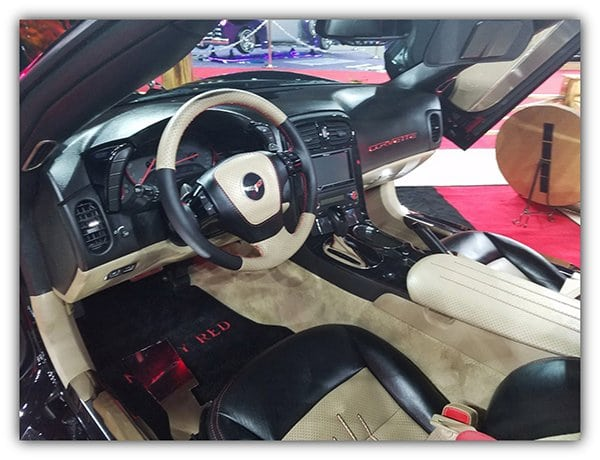 The leather to wrap and custom stitch the sun visors, gas and brake pedal booties, shifter, and the hatch strut covers were done by 5 Star Upholstery from League City, Texas.